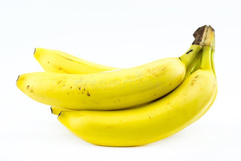 Bunt av gula bananer på en vit bakgrund fotografering för bildbyråer