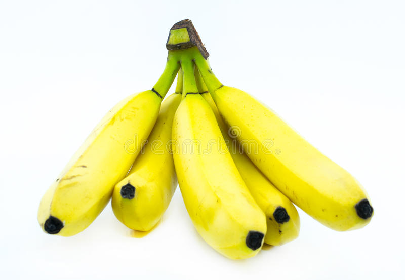 Bunt av gula bananer på en vit bakgrund - främre sikt arkivfoton