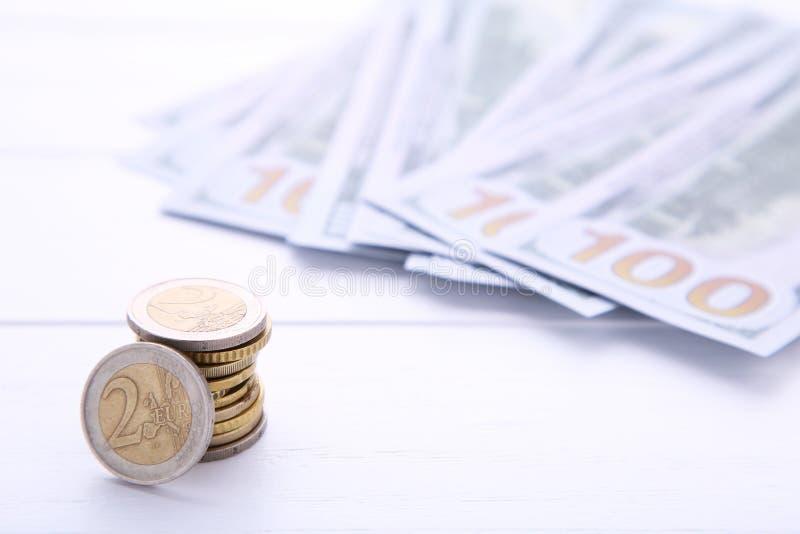 Bunt av mynt och pengar på vit bakgrund royaltyfria foton
