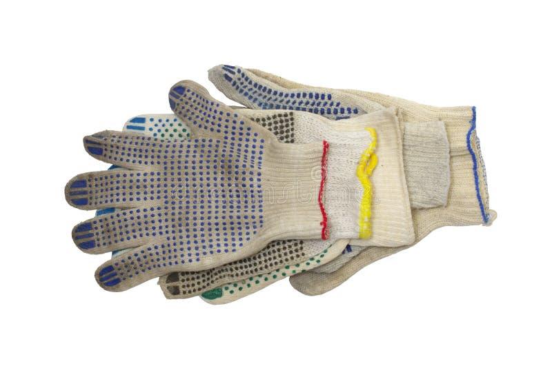 Bunt av stack funktionsdugliga handskar med färgrika rubber prickar arkivbild
