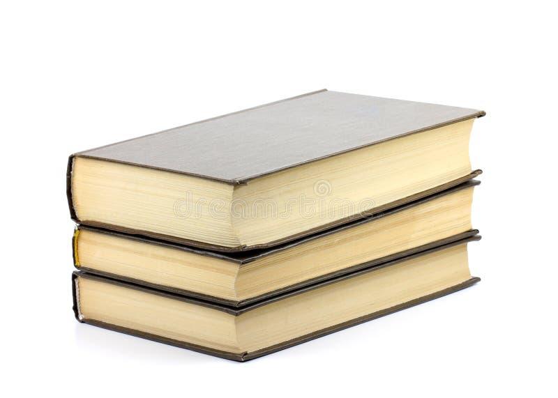 Bunt av tre böcker som isoleras på vit arkivbilder