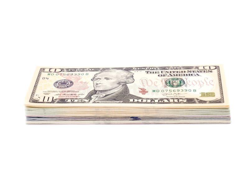 Bunt av US dollarräkningar med 10 dollar överst arkivbilder