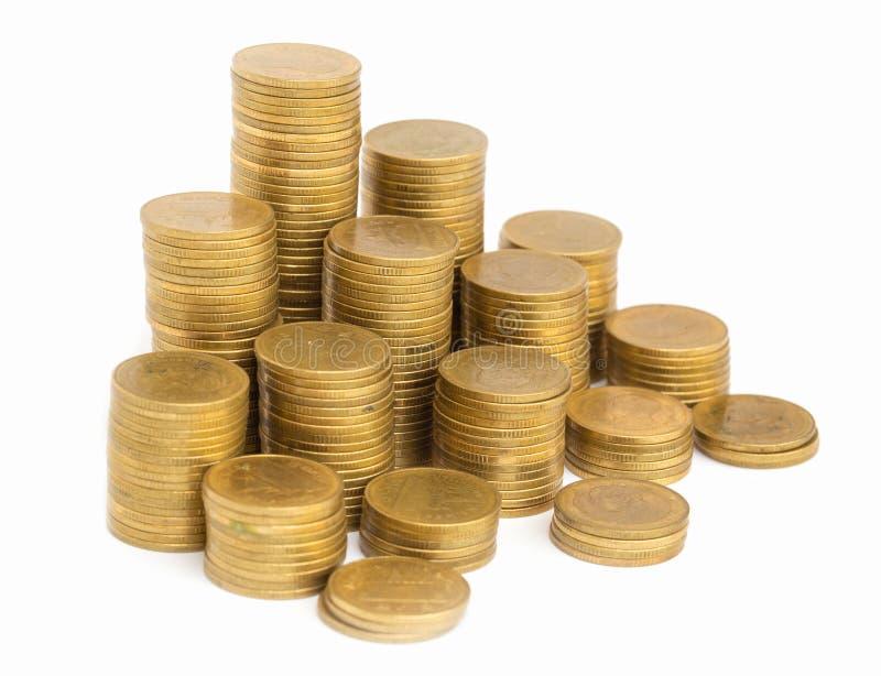 Buntar f?r guld- mynt som isoleras p? vit bakgrund Besparing v?xande aff?r f?r myntbunt Investeringpengarbegrepp arkivbilder