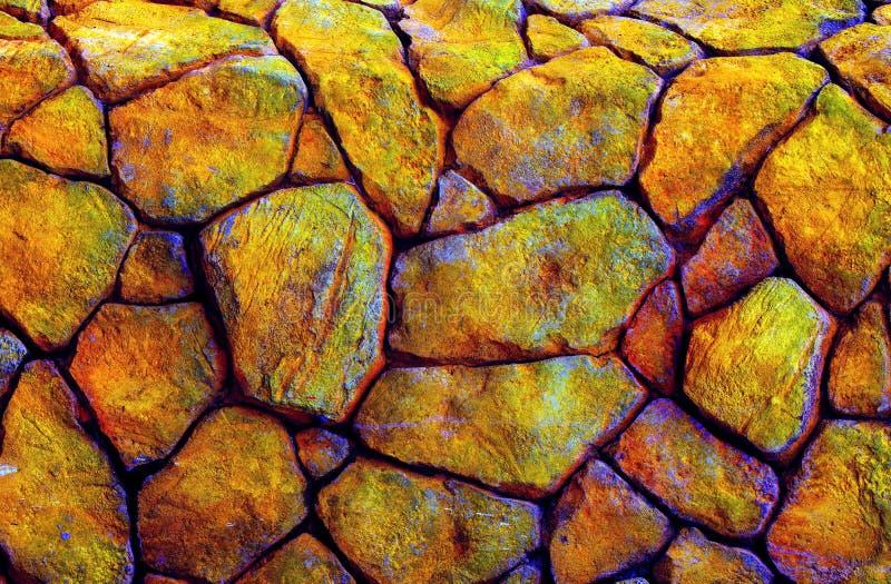Bunte Beschaffenheiten auf Steinwandhintergrund stockfoto