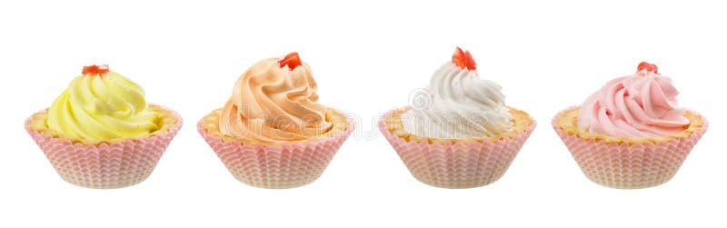 Bunte Cremekuchen lokalisiert auf weißem Hintergrund lizenzfreie stockfotografie
