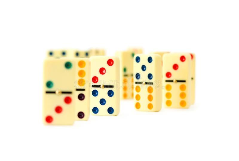 Bunte Dominos getrennt stockbilder