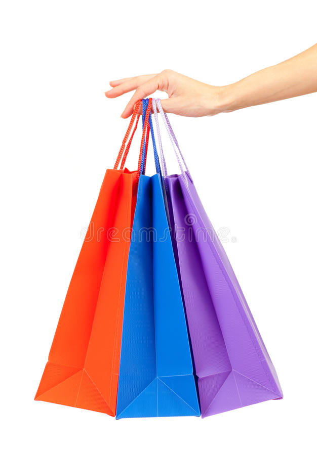 Bunte Einkaufenbeutel trennten in der Hand lizenzfreies stockbild