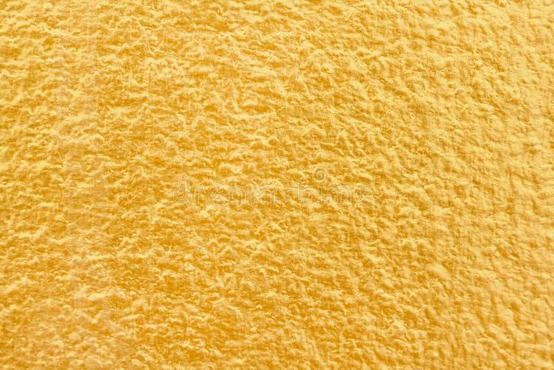 Bunte Goldfarbe auf Betonmauer mit rauer nahtloser Musterbeschaffenheitszusammenfassung für Hintergrund stockbilder