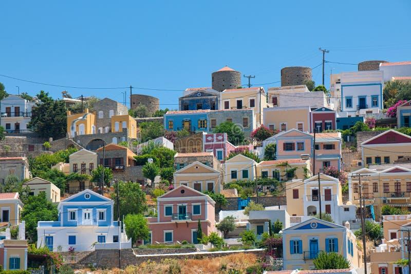 Bunte Häuser Symi-Stadt, Insel von Symi stockbild