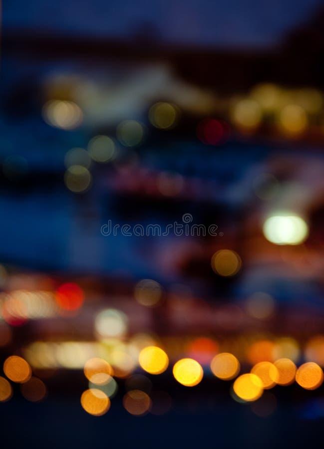 Bunte helle Lichter auf dunklem Nachthintergrund lizenzfreies stockbild