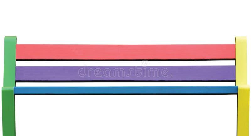 Bunte Holzbank, große ausführliche lokalisierte Sitznahaufnahme, gemalte Beschaffenheit in rosa, grün, rot, gelb, blau, altes str lizenzfreie stockfotos