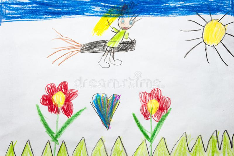 Bunte Kind-` s Zeichnung eines kleinen Hexenfliegens auf einem Besenstiel lizenzfreie stockfotos