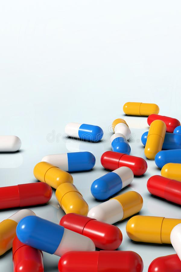 Bunte Medizinkapseln auf dem weißen Hintergrund, vertikal lizenzfreie stockfotografie