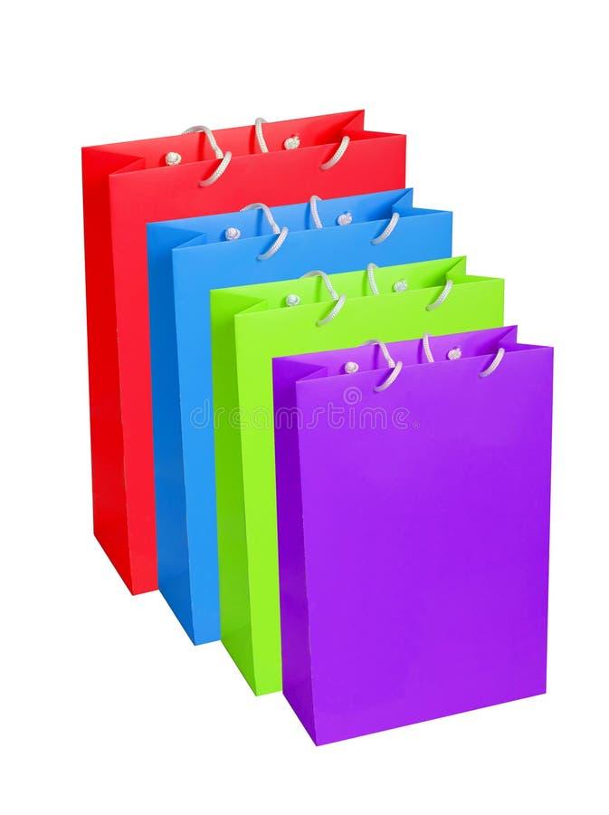 Bunte Papiereinkaufstaschen lokalisiert auf Weiß stockfotografie