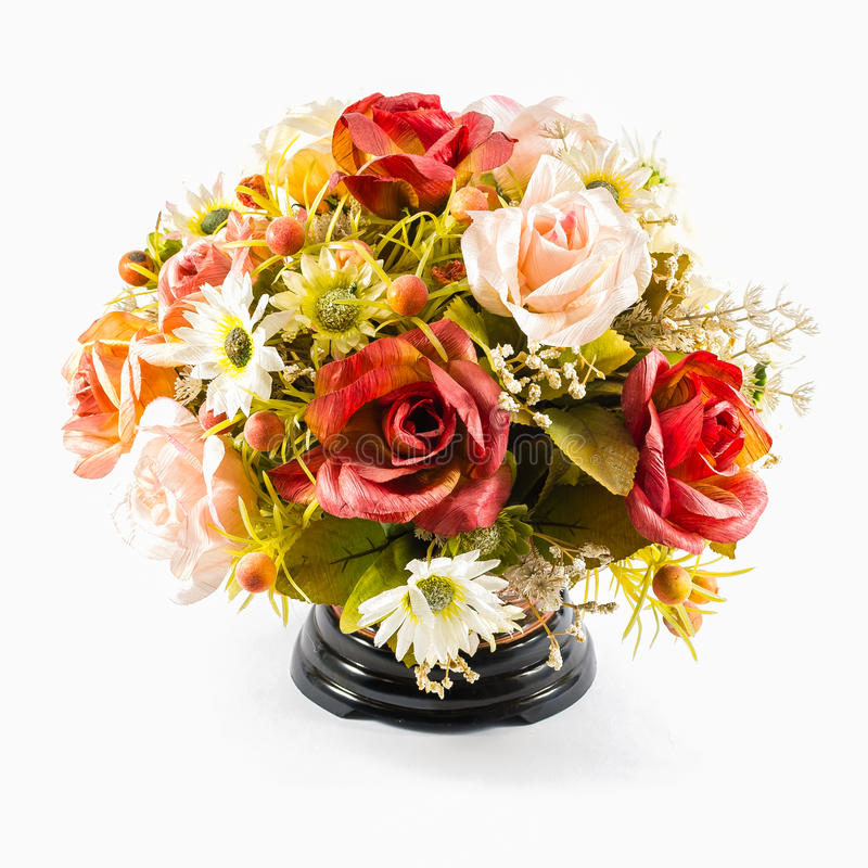Bunte Plastikblume im Vase lizenzfreie stockfotografie