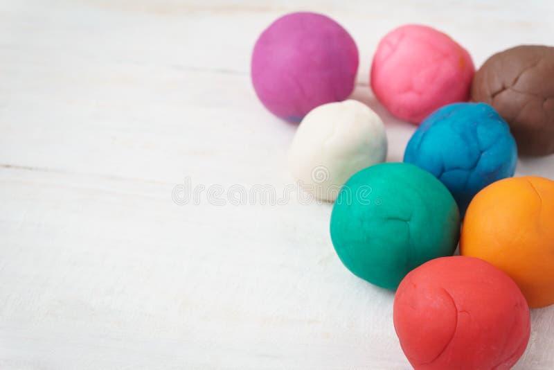 Bunte playdough Bälle lizenzfreie stockfotografie