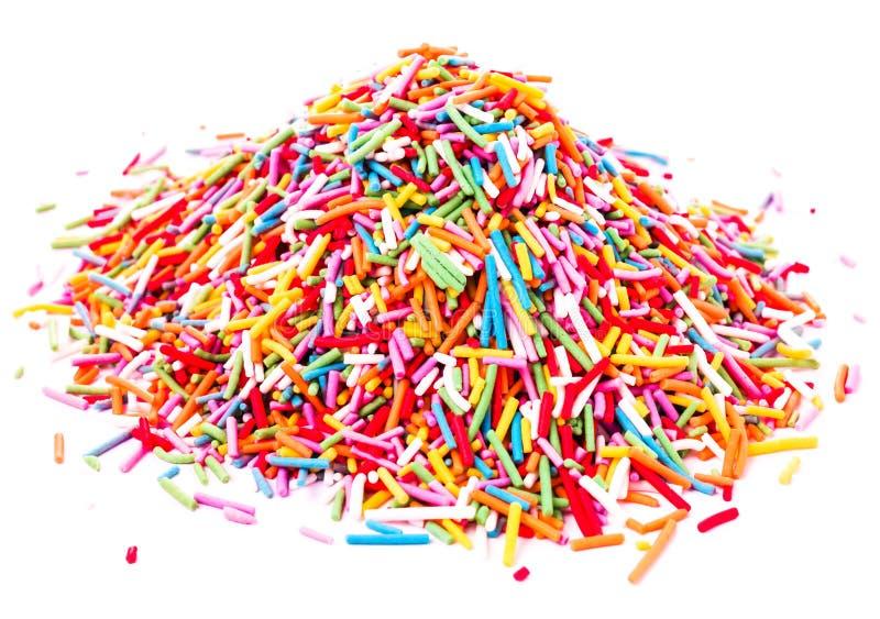 Bunte süße Zuckersüßigkeit besprüht lokalisiert auf weißem backgrou stockfotografie