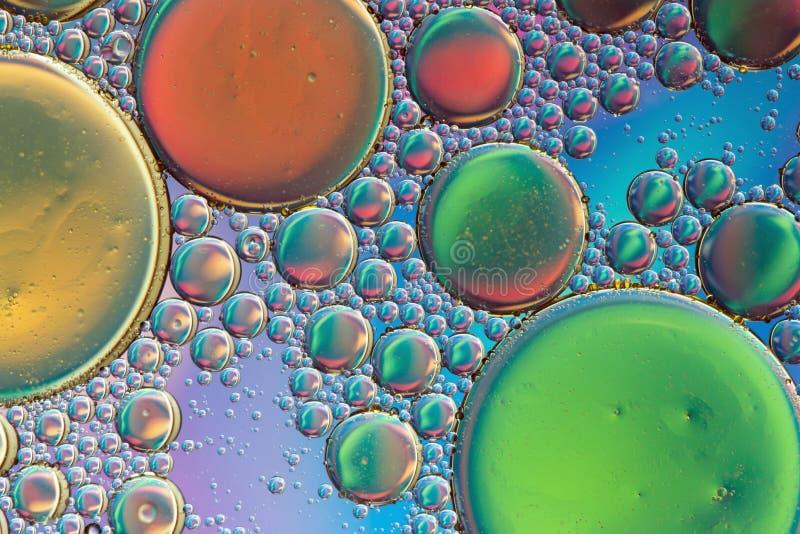Bunte, trippy psychedelische Zusammenfassung in Blauem, in Gr?nem, Orange und Gold lizenzfreies stockbild