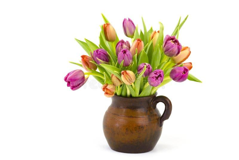 Bunte Tulpen in einem Vase lizenzfreie stockfotos