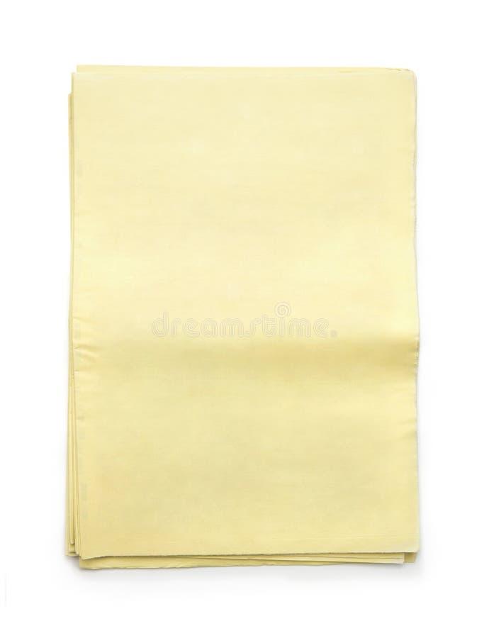 Bunt av tomma gula tidningar arkivfoto