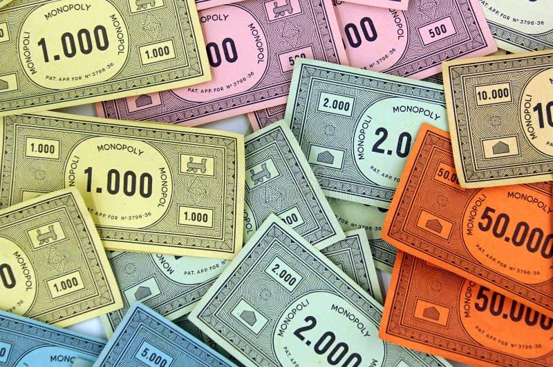 Bunter MonopolBrettspiel-Geldhintergrund stockfotografie