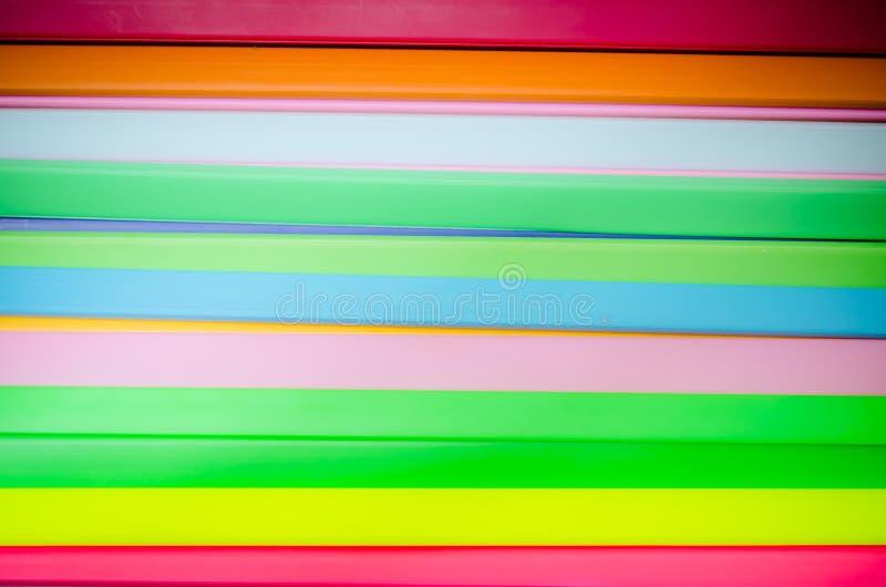 Bunter Plastikhintergrund stockfotos