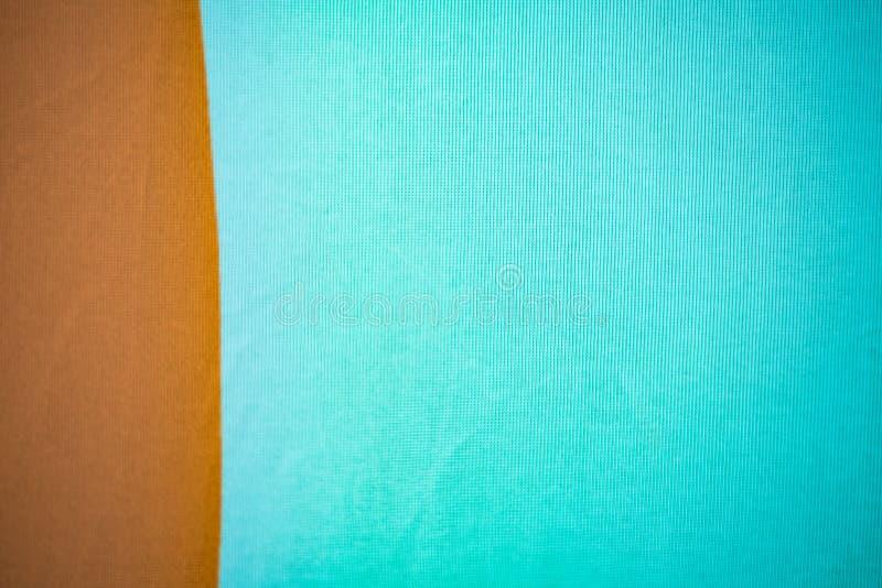 Buntes Braun mit blauem Gewebehintergrund für die Werbung der Fahne lizenzfreie stockfotografie