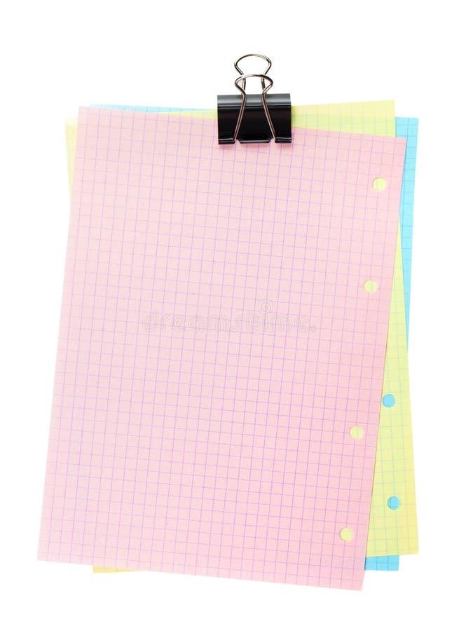 Buntes gezeichnetes Büropapier mit Klipp stockfotos