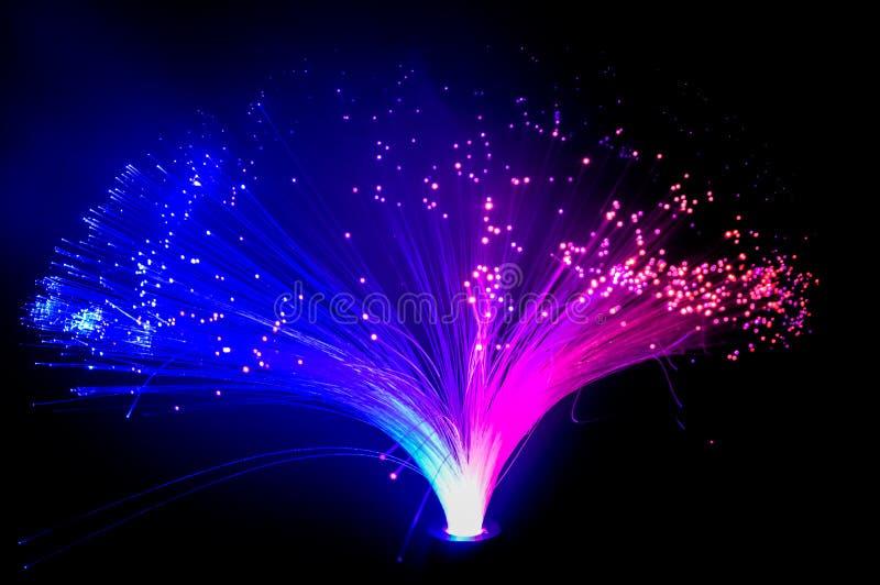 Buntes Glühen blaue und purpurrote Lichter lizenzfreie stockbilder