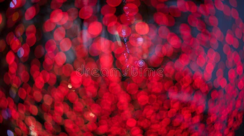 Buntes Rot des abstrakten bokeh Licht-Hintergrundes stockbilder