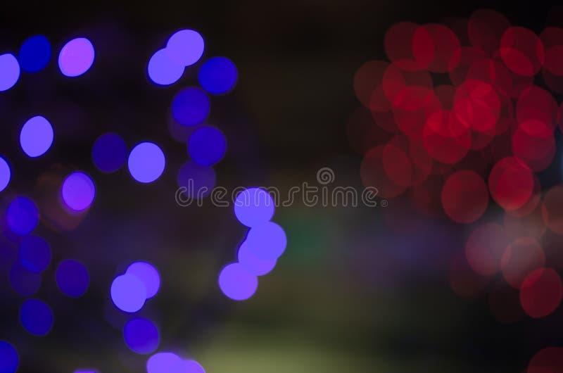 Buntes Unschärfe bokeh feenhaftes StraßenlaterneFestival, Nachtdefocused u. dunkler Hintergrund stock abbildung