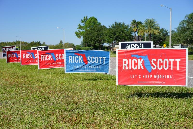 Buntes Wahlabstimmungszeichen, das für Rick Scott für Florida-Gouverneur wählt stockbild