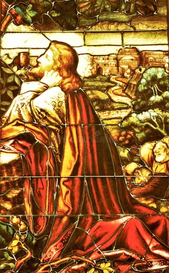 Buntglasfenster von Jesus-Beten lizenzfreies stockfoto