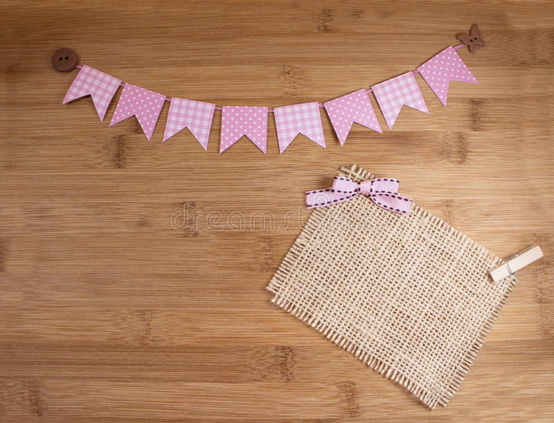 Bunting banners. Cute pink bunting banners on wooden background royalty free stock photo