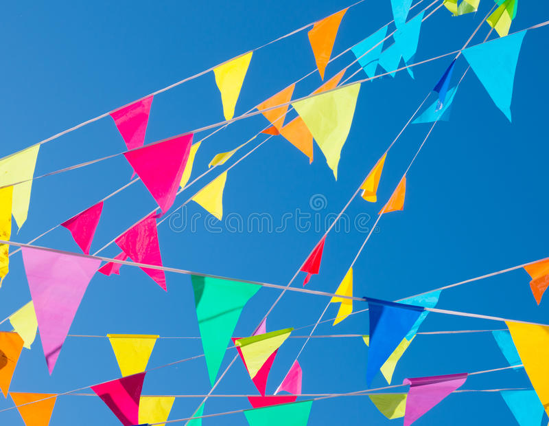 Bunting flags. Colorful bunting flags against a blue sky royalty free stock photography