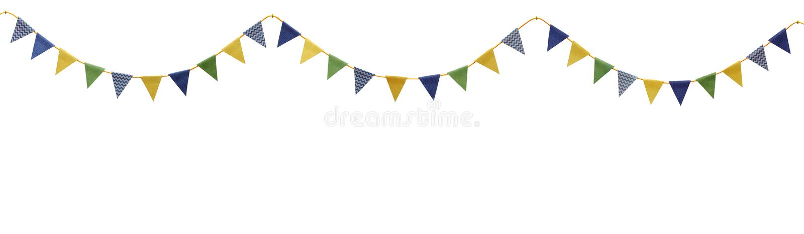 Bunting party flags made from scrap booking paper. Isolated on white royalty free stock photo
