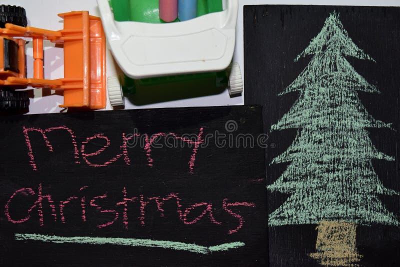 Buon Natale del testo - fondo di festa del nuovo anno - lavagna nera fotografie stock