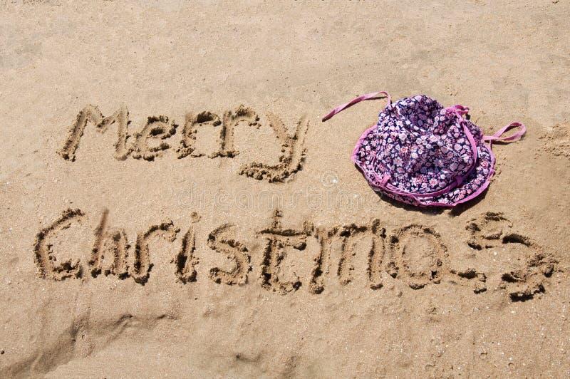 Buon Natale scritto nella sabbia immagini stock libere da diritti