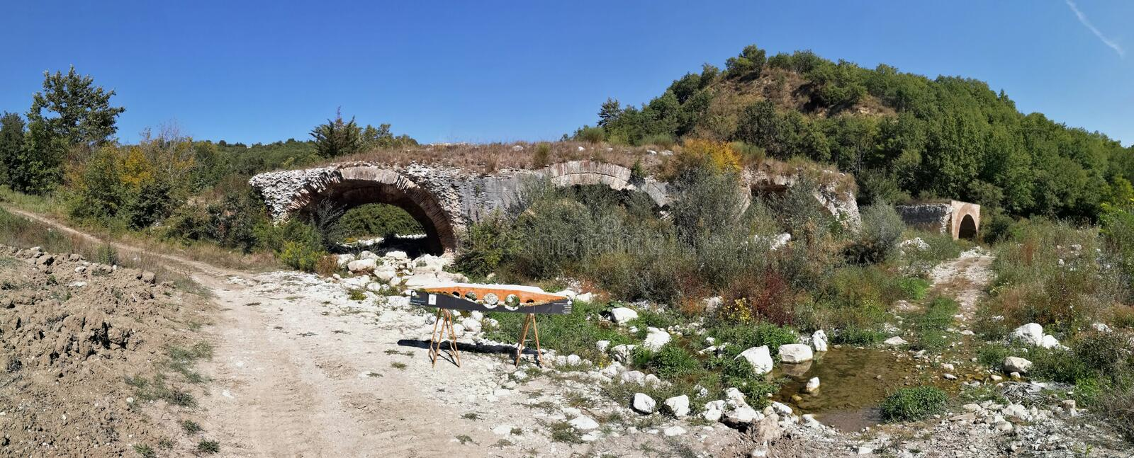 Buonalbergo - Overview of the Ponte delle Chianche. Buonalbergo, Campania, Italy - September 24, 2017: Panoramic photo of the ruins of the Ponte delle Chianche royalty free stock photos