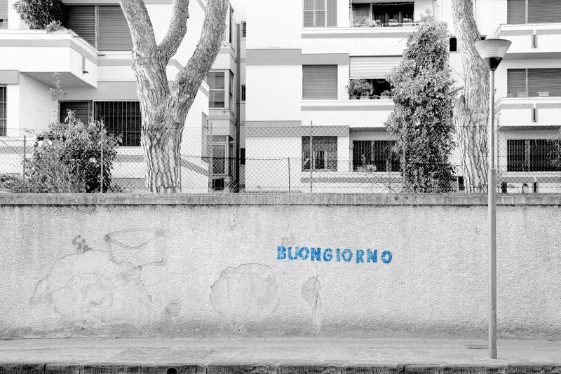 ¡Buongiorno! Buena mañana Pisa, Italia, mundo - un ful escrito azul fotografía de archivo libre de regalías