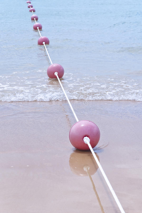 Buoy. Red buoy in the beach with ropes stock photography