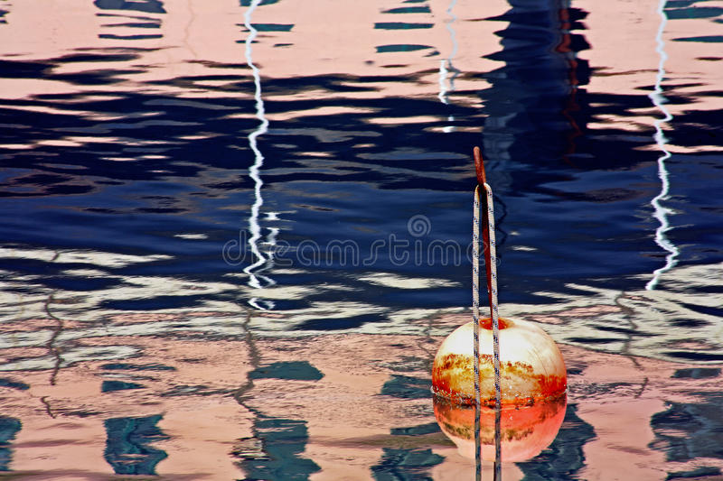 Buoy dream, reflections in the water royalty free stock image