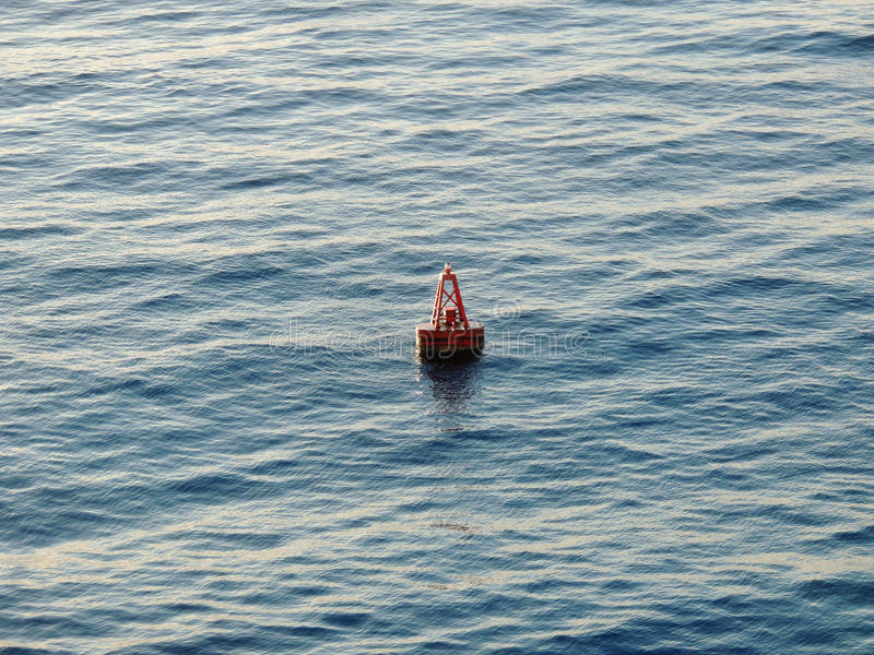 Buoy Floating in the Ocean. Centered of Float in the Ocean royalty free stock image