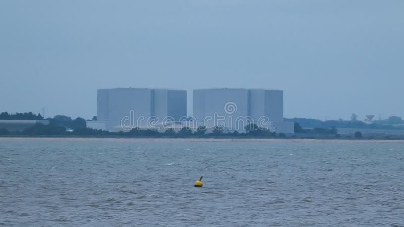 Buoy in front of a nuclear power station in England before the storm stock images