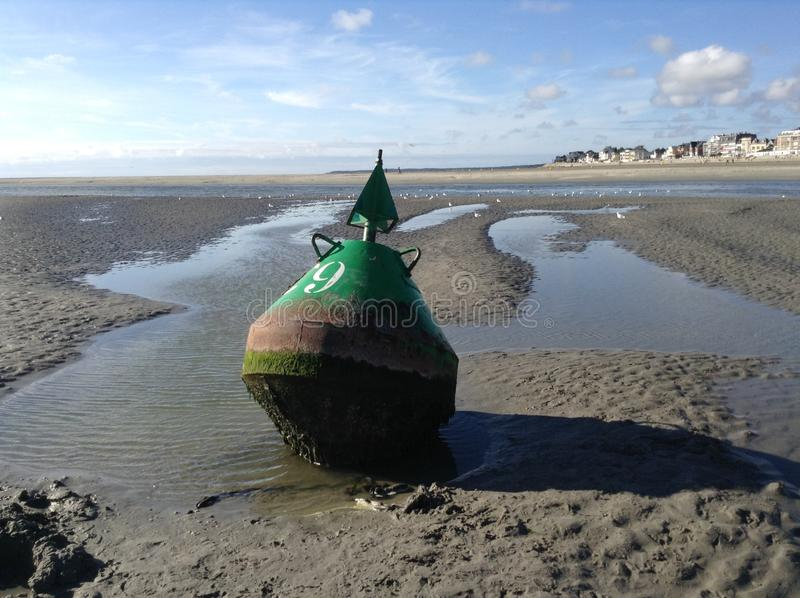 Buoy on the ground. A buoy on the ground because of low tide in le crotoy stock images