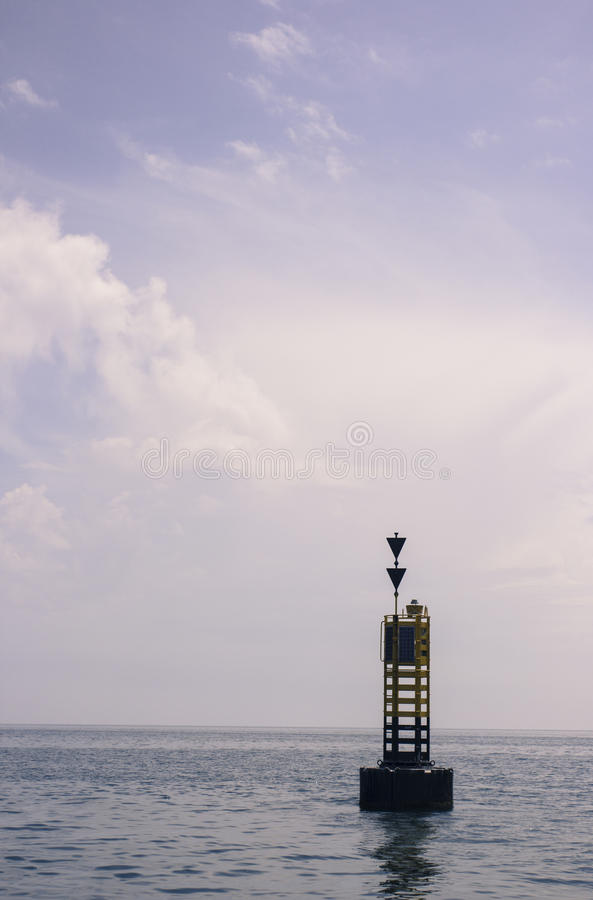 Buoy in the sea stock photography