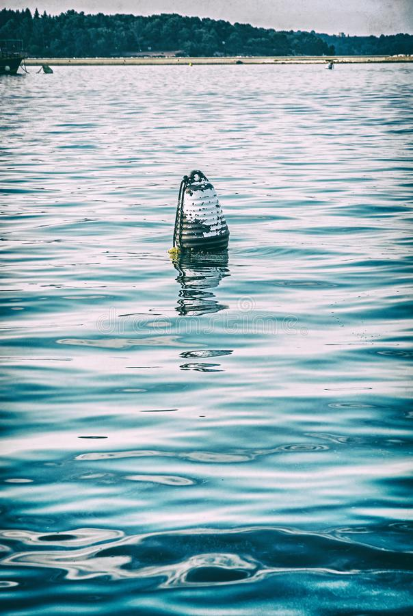 Buoy in the water, Adriatic Sea, analog filter royalty free stock photos