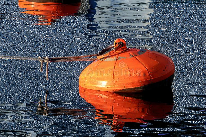 Buoy and water reflections royalty free stock image