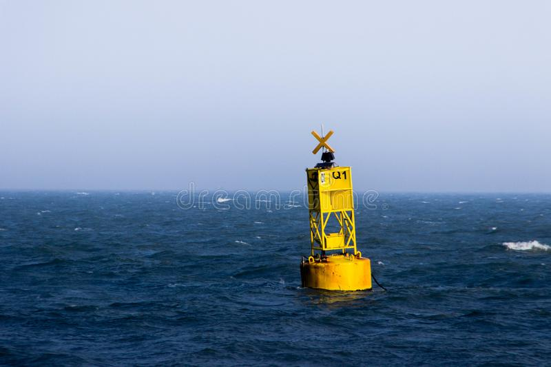 Buoy. Yellow Buoy floating in the sea royalty free stock photography