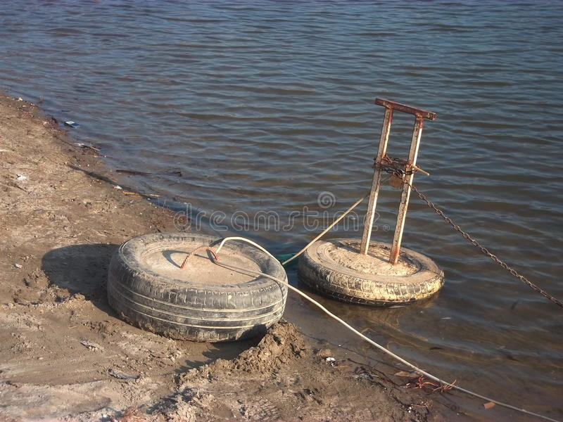 Buoys for anchoring boats. On the coast stock image